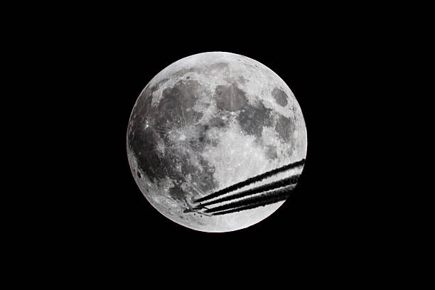Full Moon Close Up and Plane Passing stock photo
