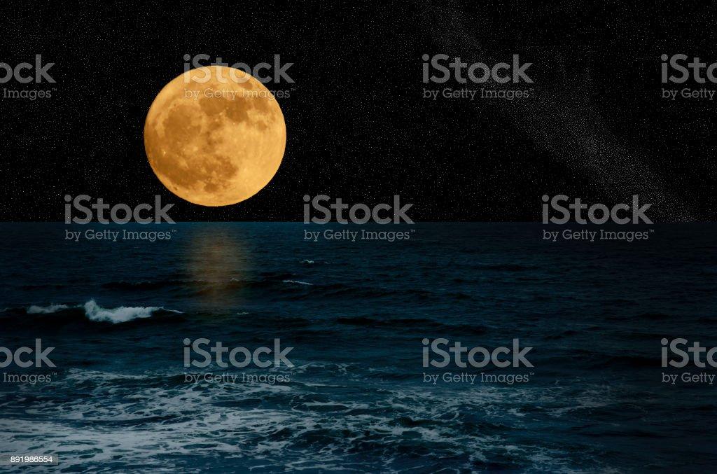 Full moon from the sea stock photo