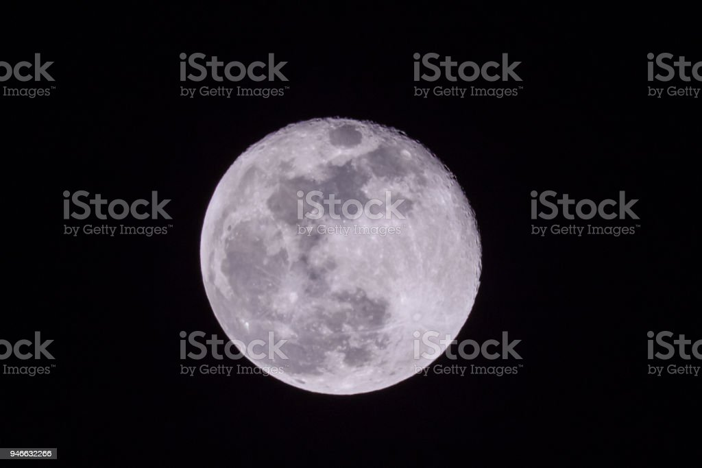 Full moon in a sky at night stock photo