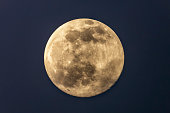 istock Full moon in the dark winter night with clearly visible moon surface during a weak partial eclipse 1310071378