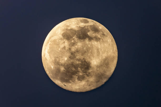 Full moon in the dark winter night with clearly visible moon surface during a weak partial eclipse stock photo