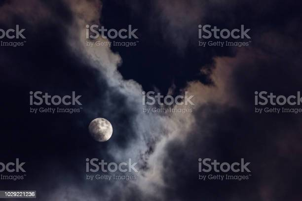Photo of Full moon in the middle of clouds