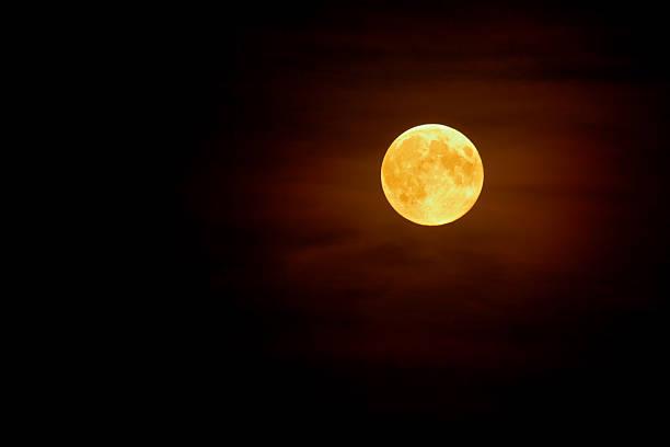 Full moon in the mist on dark night sky background stock photo