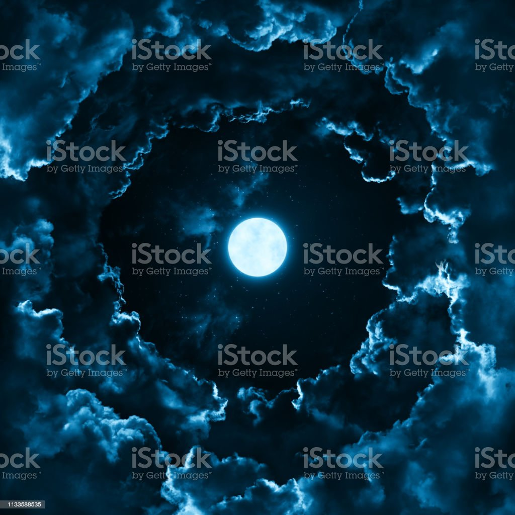 Full moon in the mystical midnight sky with stars surrounded by...