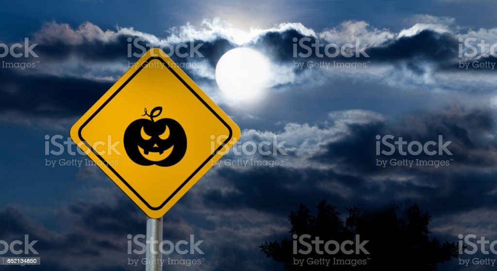 Full Moon in the Night Sky and Halloween Road Sign - Pumpkin stock photo