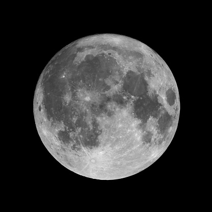 Full moon isolated on black night sky background. 99,7% of Moon visible just before full moon phase.