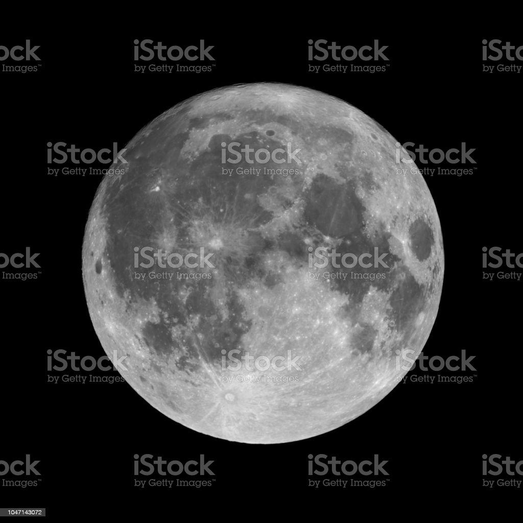 Full moon isolated on black night sky background stock photo