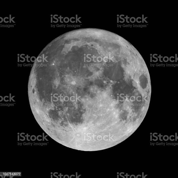 Photo of Full moon isolated on black night sky background