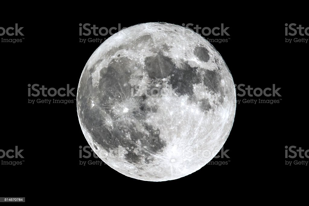 Full Moon isolated on black The full Moon is seen isolated on a black background. High contrast, high resolution image taken with a full frame dslr camera. Astrology Stock Photo