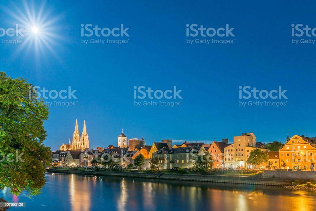 Full moon night in Regensburg with danube river and dome stock photo