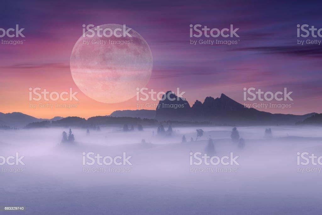 Full moon on idyllic fantasy scenery and misty scene foto stock royalty-free