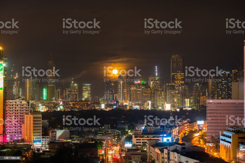 Full Moon over Bonifacio Global City or BGC, in Taguig City, Philippines stock photo