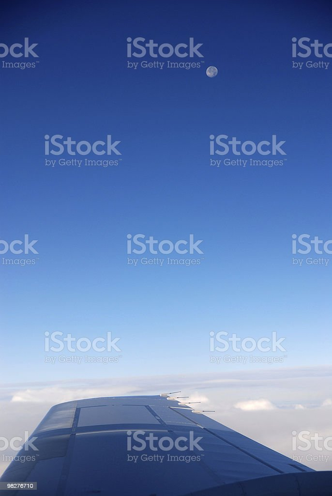 full moon over cloudscape during flight royalty-free stock photo