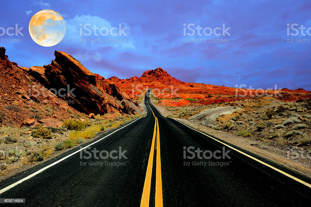 Full moon over Desert road stock photo