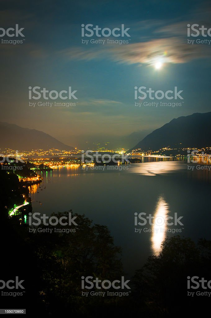 full moon over lake maggiore in Switzerland royalty-free stock photo
