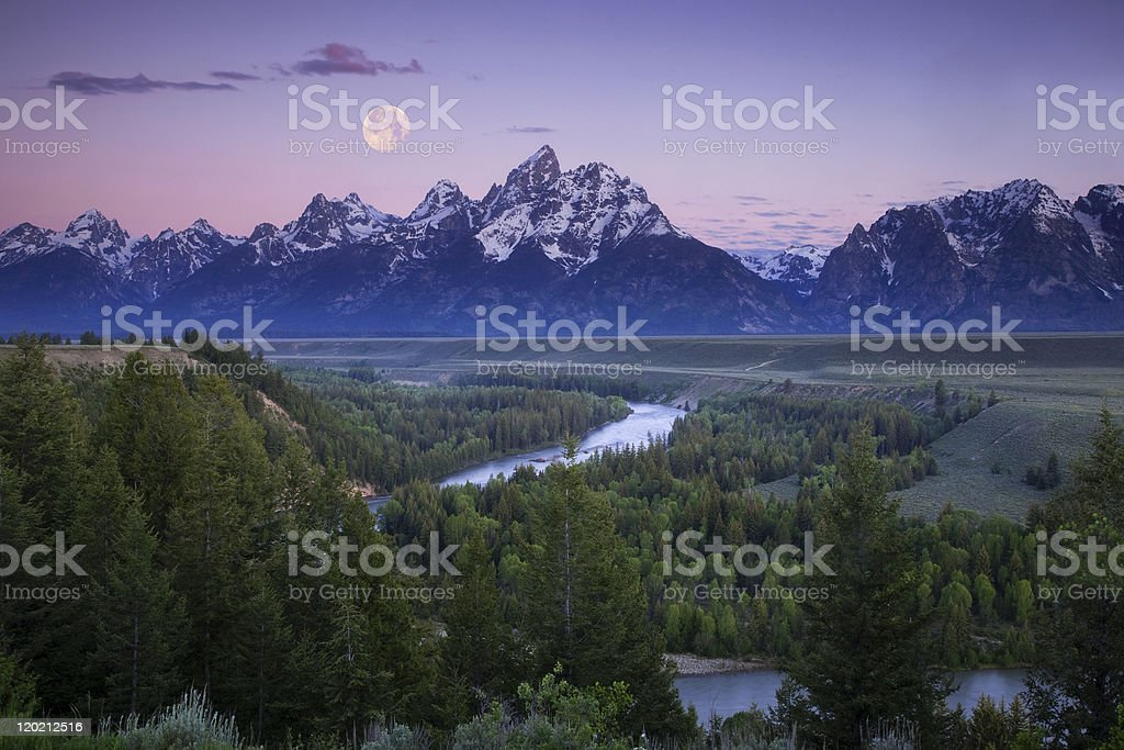 Full Moon Over the Teton Peaks stock photo