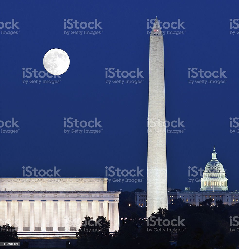 Full moon over Washington Memorial with buildings stock photo