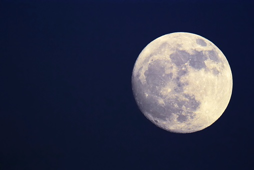 Full moon with visible surface.