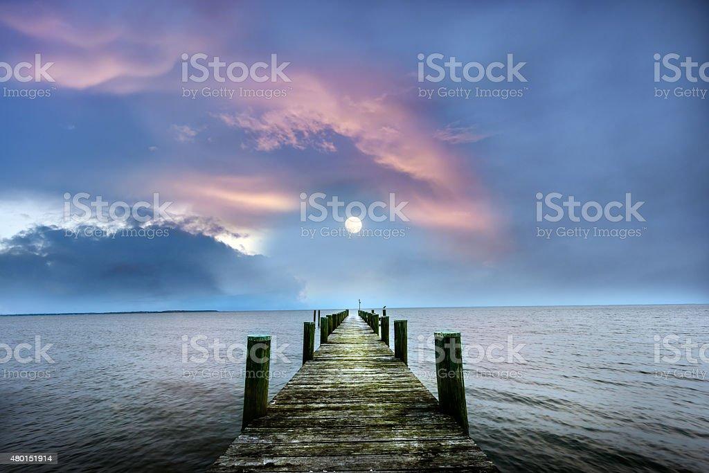 Full Moon rising over a Chesapeake Bay Pier stock photo
