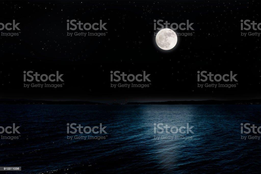 Full moon rising over the peninsula stock photo