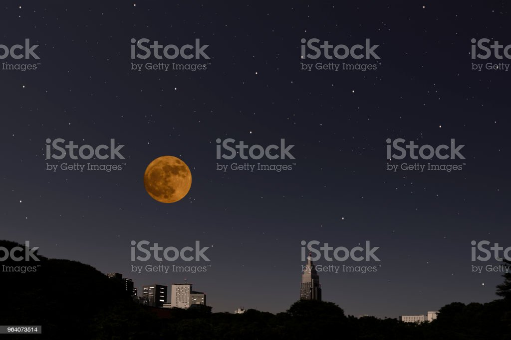 Full moon rising over the Skyscraper and lots of stars - Royalty-free Architecture Stock Photo