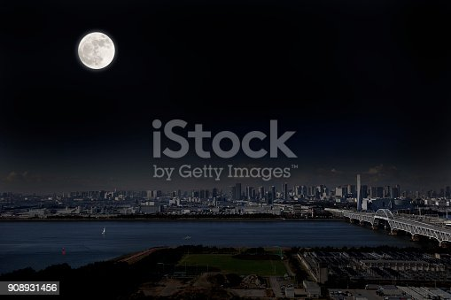 Full moon rising over the Tokyo urban skyline with copy space.