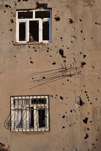 full of bullet holles and broken windows stock photo