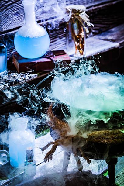 full of magic mixture witcher cauldron with blue potions - pfannen test stock-fotos und bilder