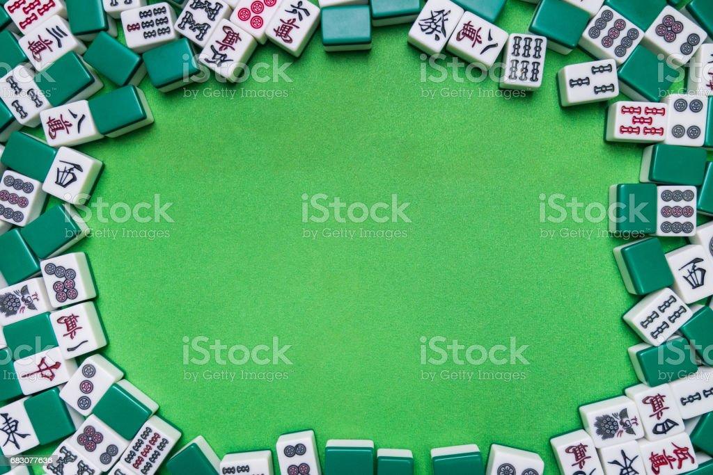Full of Mahjong tiles game on green background foto de stock royalty-free