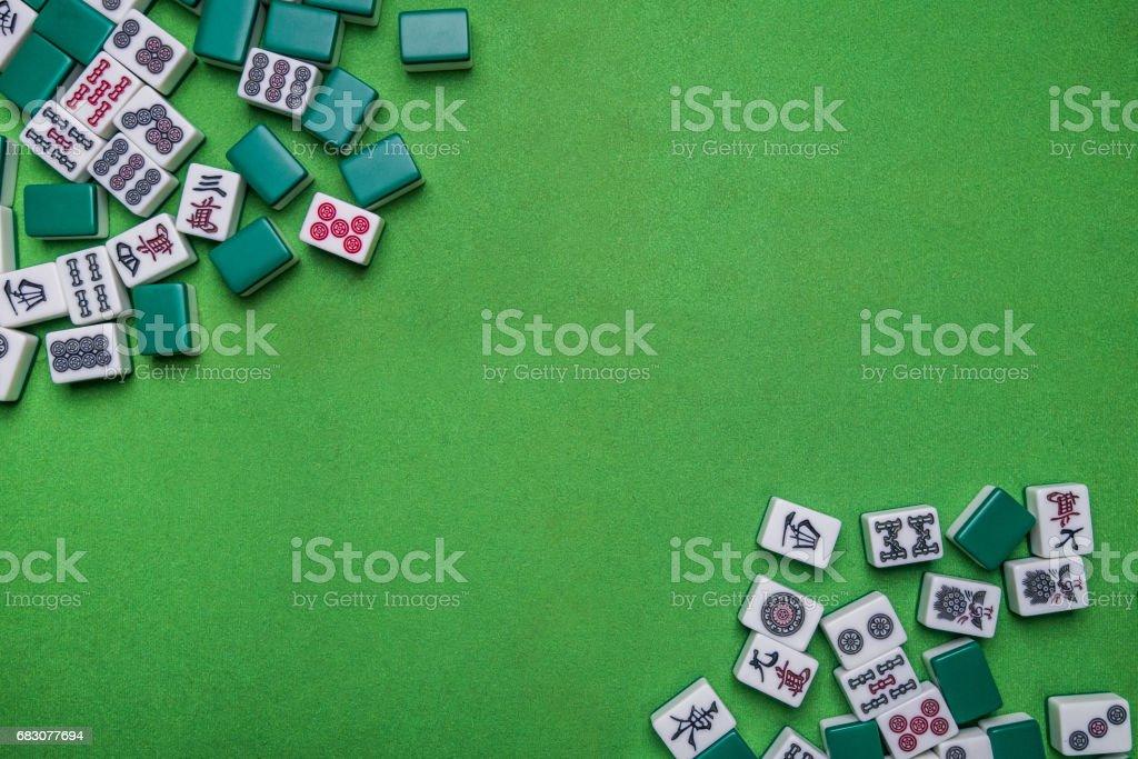 Full of Mahjong tiles game on green background zbiór zdjęć royalty-free