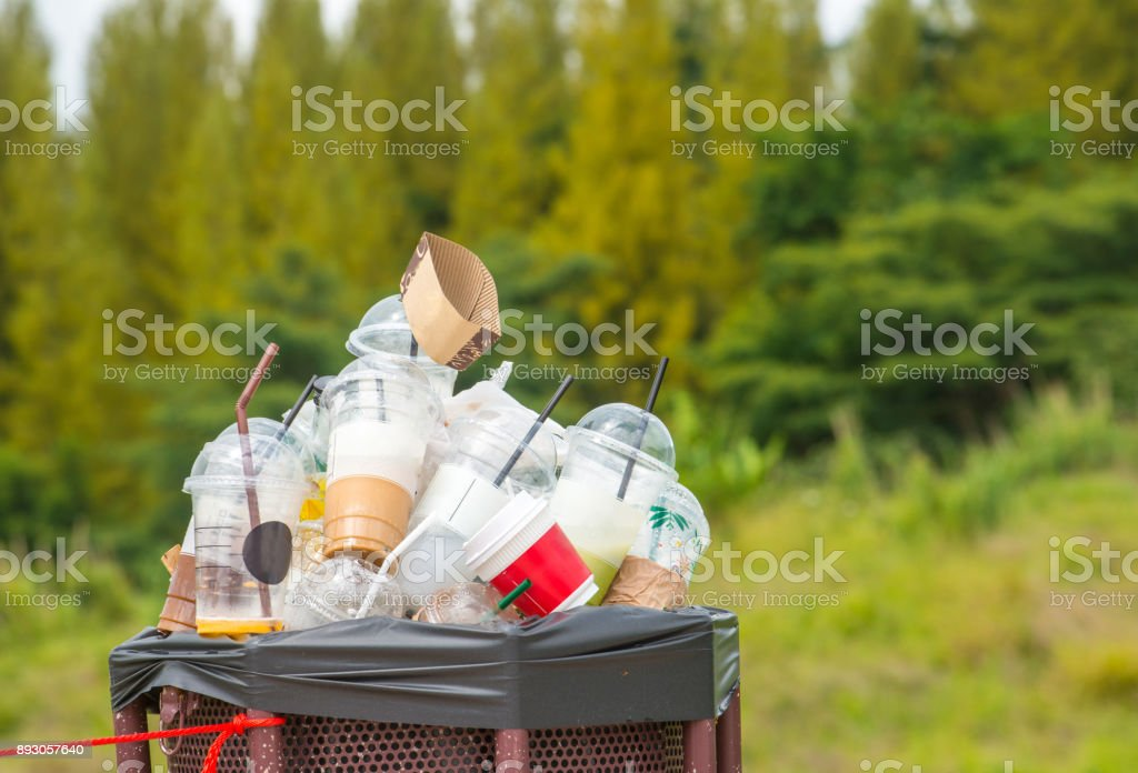 Full of plastic cup in recycle bin in the nature. stock photo