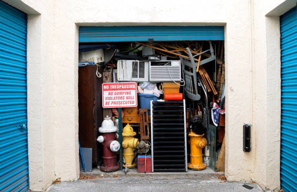 Full Overflowing Storage Unit Bursting with Heap of Junk  greed stock pictures, royalty-free photos & images