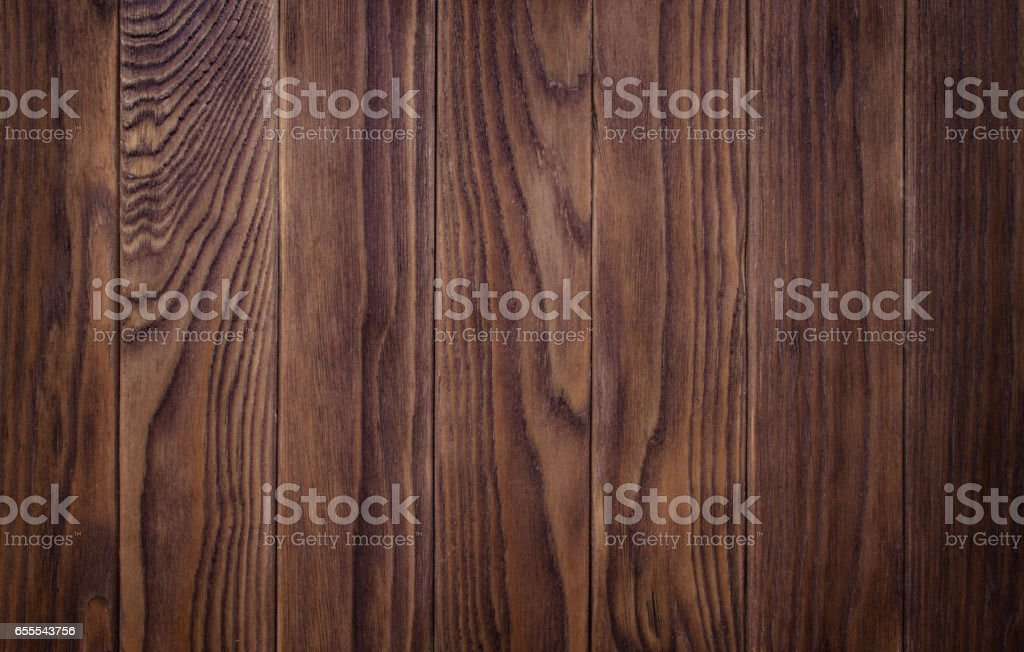 full page of dark stained, distressed wooden floor board texture stock photo
