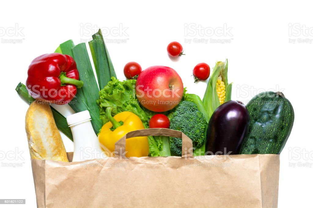 Full paper bag of different health food on a white background stock photo