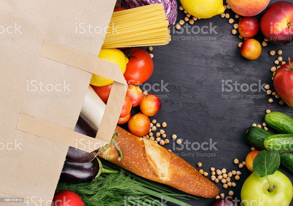 Full paper bag with different helpful food stock photo