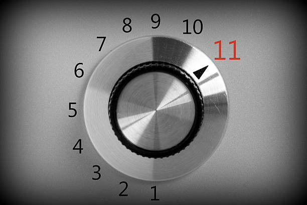 Full Power Black and white image of a volume or power control switch on a metal background that goes all the way up to the number eleven. knob stock pictures, royalty-free photos & images