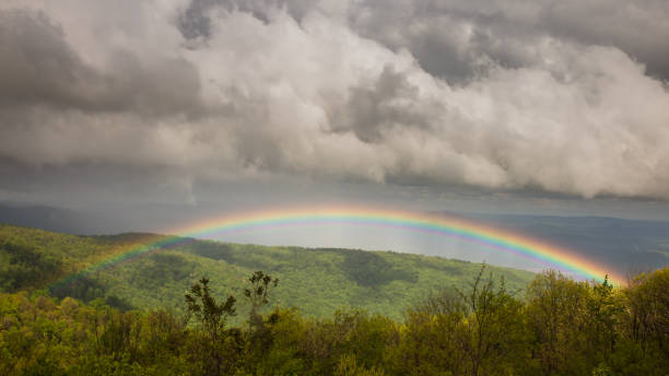 Full rainbow over the forest in Shenandoah National Park stock photo