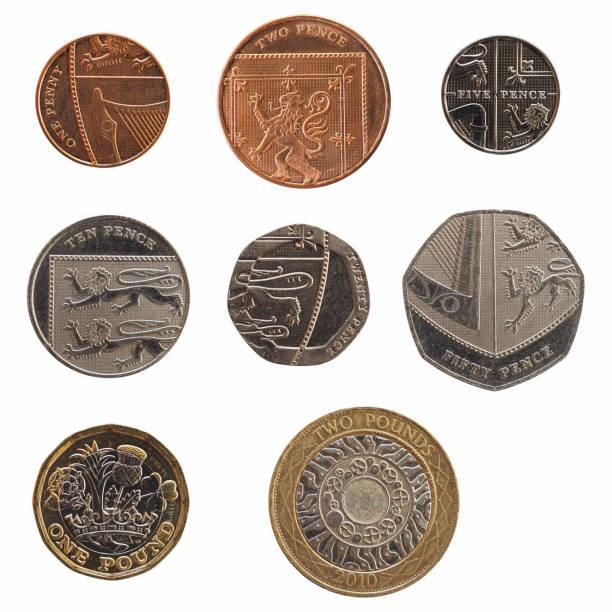 Gama completa de moedas do Reino Unido isolado sobre o branco - foto de acervo