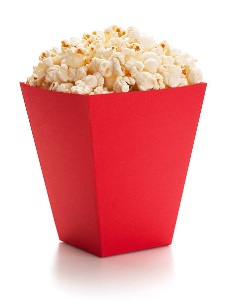Full red bucket of popcorn. stock photo