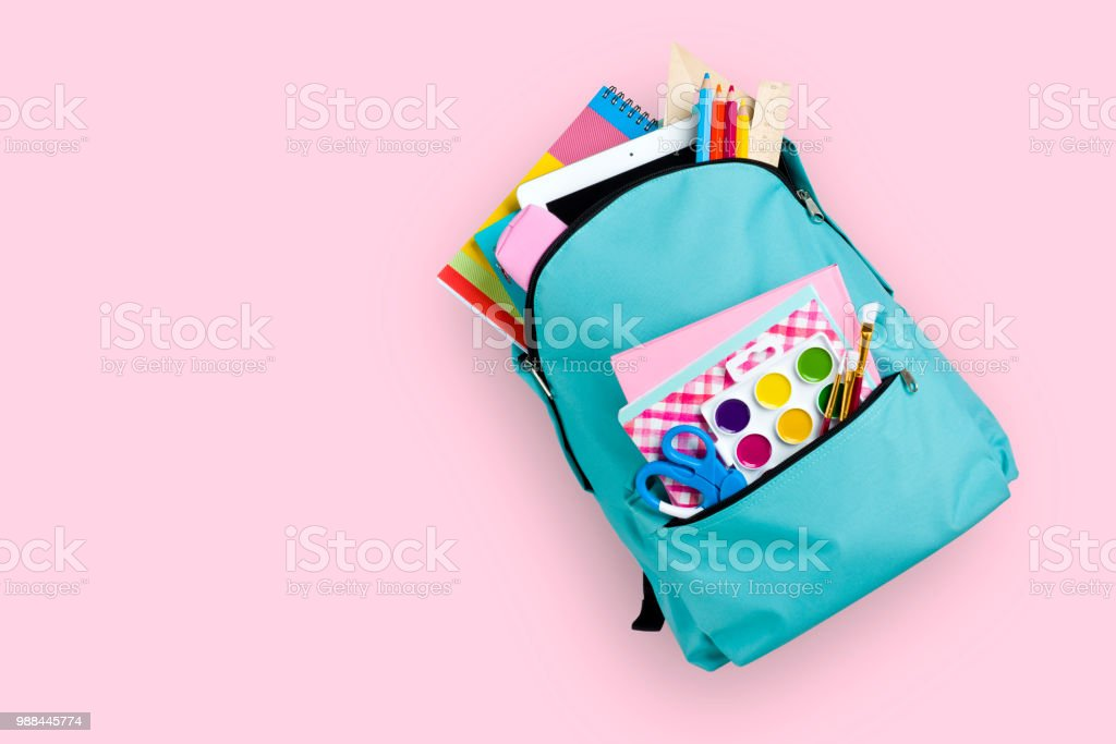 Full school backpack isolated on pink background stock photo
