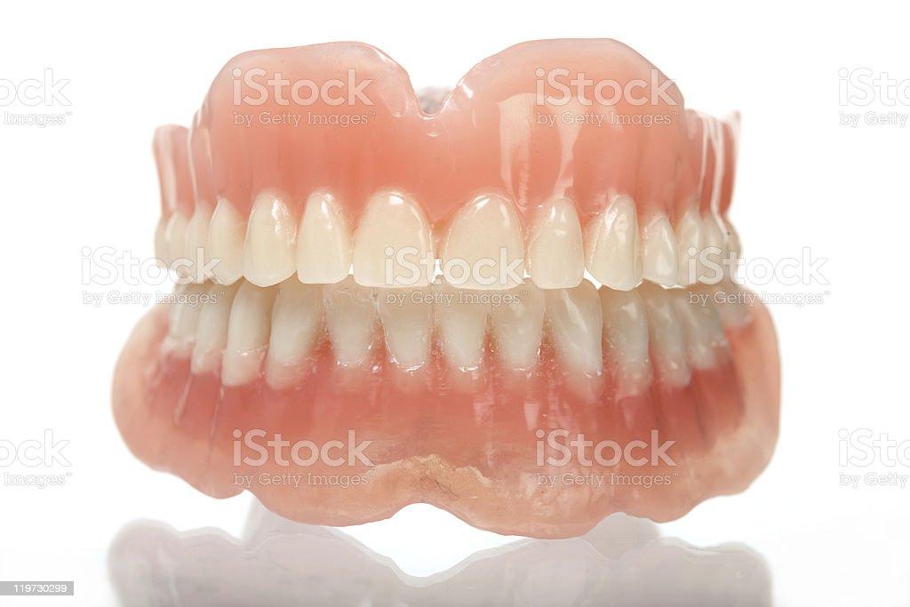 Full set of acrylic dentures isolated on white stock photo