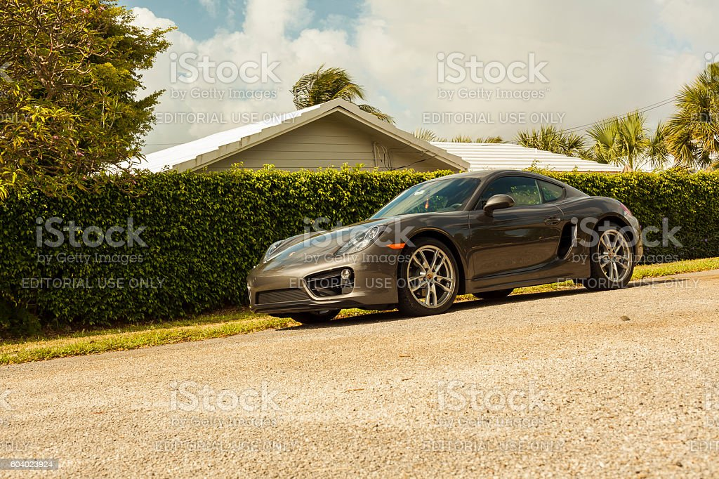 Full shot Porsche Cayman in residential area in Miami stock photo