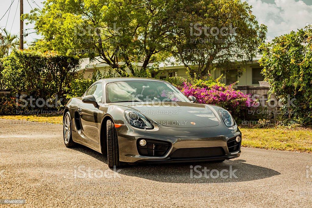 Full shot Porsche Cayman in residential area Miami, USA - April 30, 2016: Full shot Porsche Cayman in residential area Porsche Stock Photo