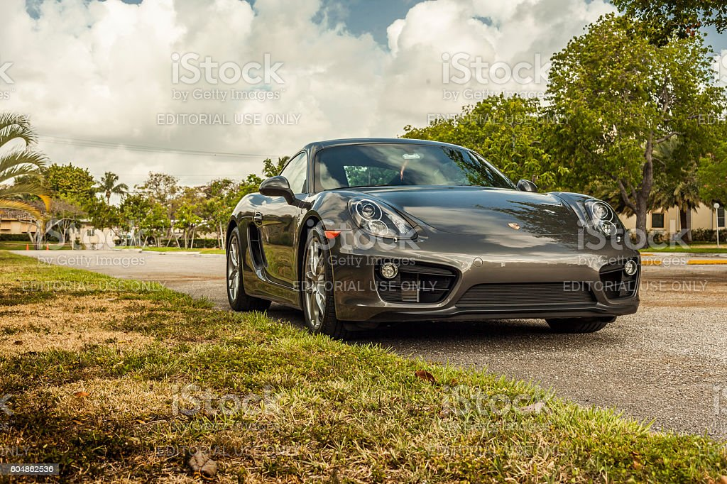 Full shot Porsche Cayman in residential area stock photo