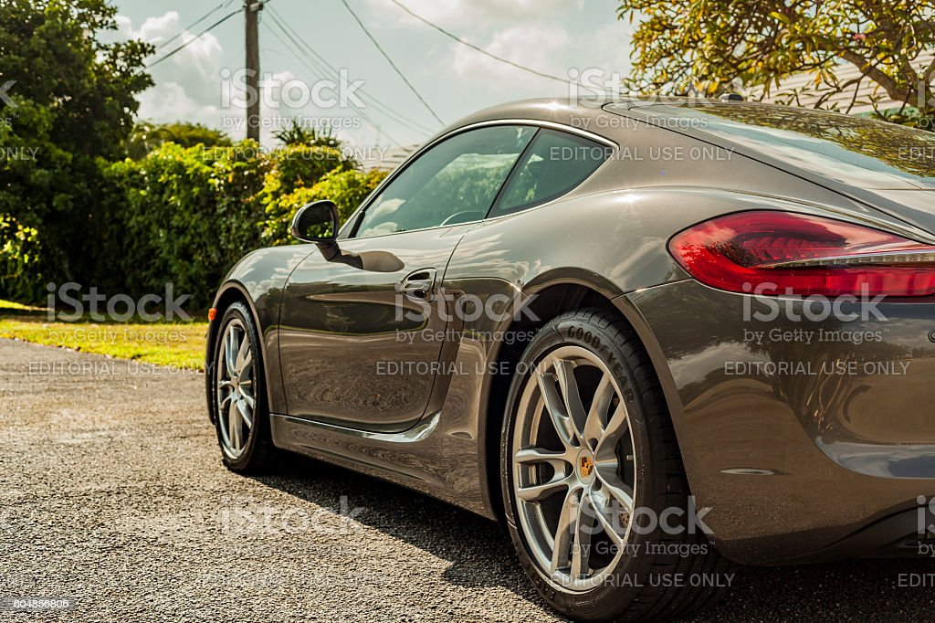Full shot sideways. Porsche Cayman in residential area stock photo