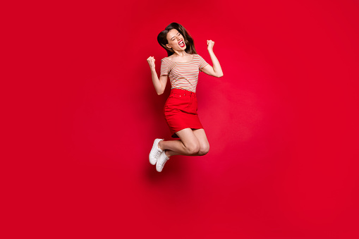 Full size body length photo of pretty cool hipster teen lady gesturing fists isolated bright background