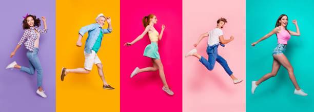 cuerpo de tamaño completo vista retrato de alegres alegre alegría de la gente deportiva soñada en una camiseta a rayas overoles actividad estilo de vida sueño aislado en diferentes colores brillantes vivos brillo fondo - moda de zapatos fotografías e imágenes de stock