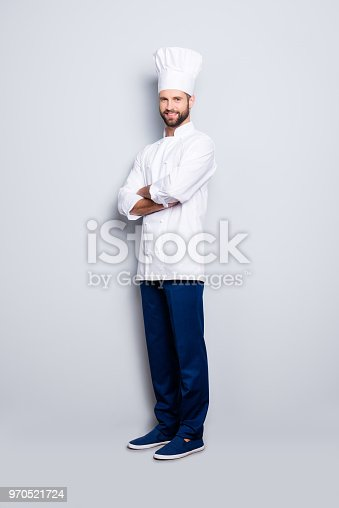 istock Full size body portrait of joyful positive chef cook with stubble in beret, having his arms crossed, isolated over grey background, looking at camera 970521724