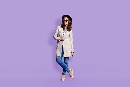 Full size fullbody portrait of charming pretty girl in street look posing looking away isolated on violet background, rest relax leisure  weekend holiday concept