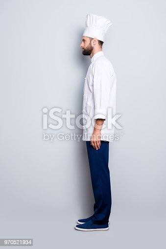 istock Full size fullbody snap, profile portrait of attractive, harsh, virile chef cook with stubble in beret, isolated over grey background 970521934